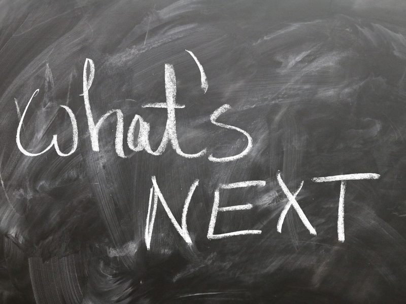 Picture of a blackboard with what's next written in white chalk