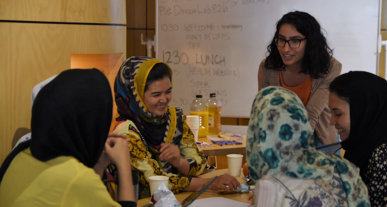 Picture of Mariam Mohammed talking to a group of women