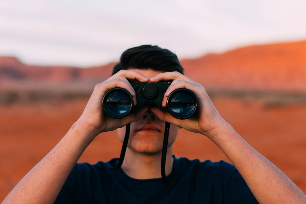 Image of man with binoculars with red desert in the background. On the 25th of November Amanda Rishworth, Shadow Minister for Youth, called for a Youth Recovery Strategy. Here's one we prepared earlier.